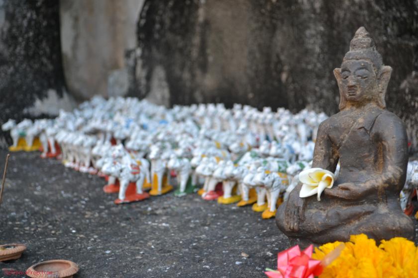 Minature buddha with an elephant army.